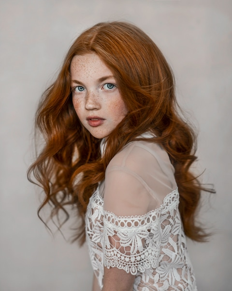 light and delicate close painterly portrait of red hair girl with freckles