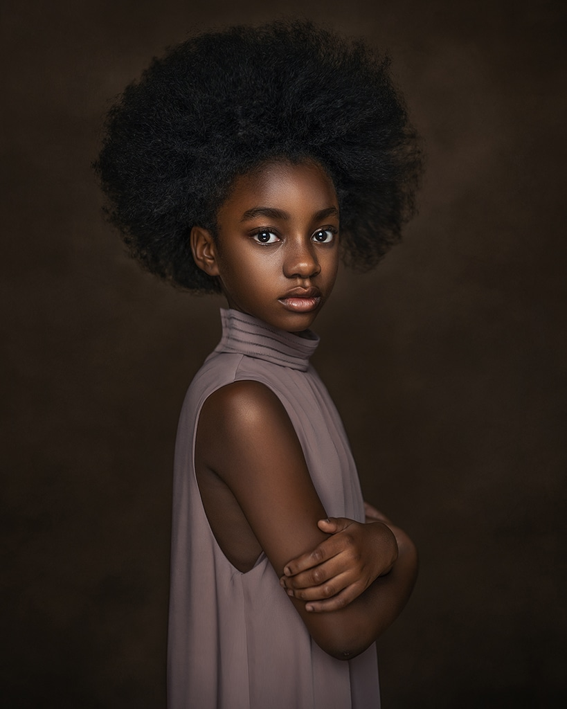 afro American girl posing for her portrait wearing lavender top