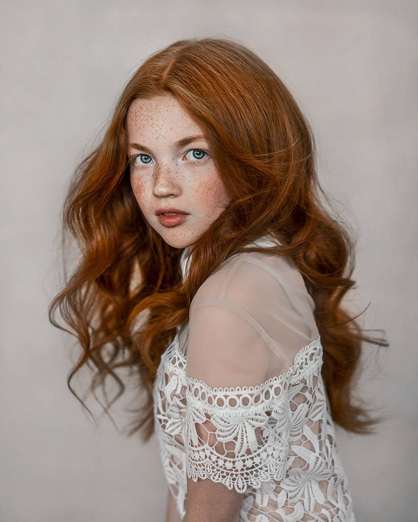 fine art photography portrait of a ginger girl with freckles