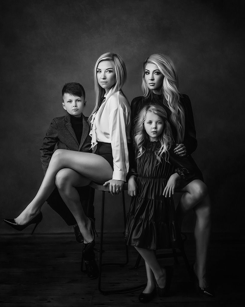 LBGTQ family with two moms celebrating the bond with their kids, lesbian moms being proud of their family, black and white family photography