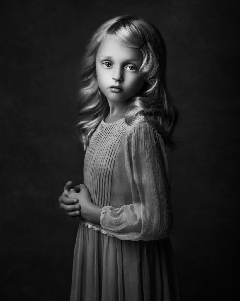 black and white portrait of young girl showing the Rembrandt lighting technique